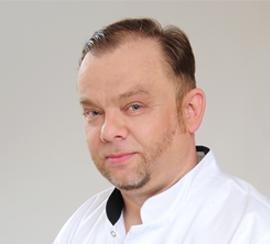 Dr Janusz Srzypczynski,  DDS, MSc (Implantology)
